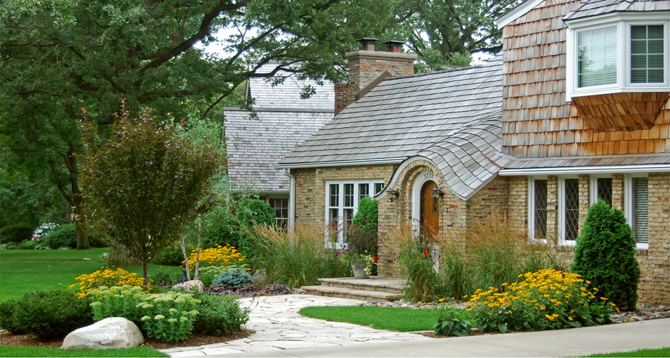 "This ""Cape"" Influenced Home was Updated Using Flagstone for the Walkway/Stoop and a Varied Selection of Plantings."