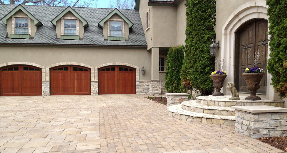 "With this ""European Inspired"" Home, We Achieved this ""Auto-Court"" Using the Combination of Irregular Limestone and Pavers."