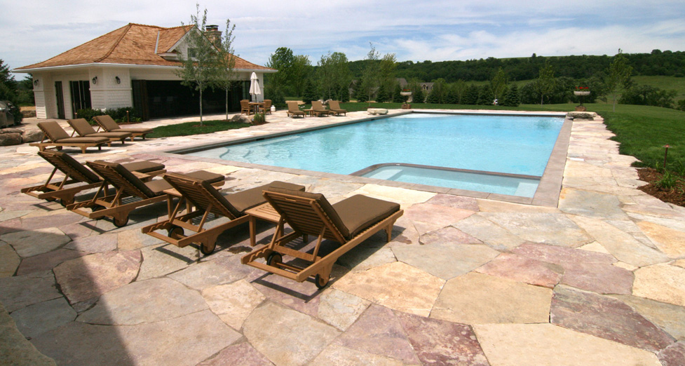 "This ""Farmstead"" in S. Minnesota Wanted Space to Entertain; We Designed a Large Pool/Spa Combo, with a Limestone Patio."