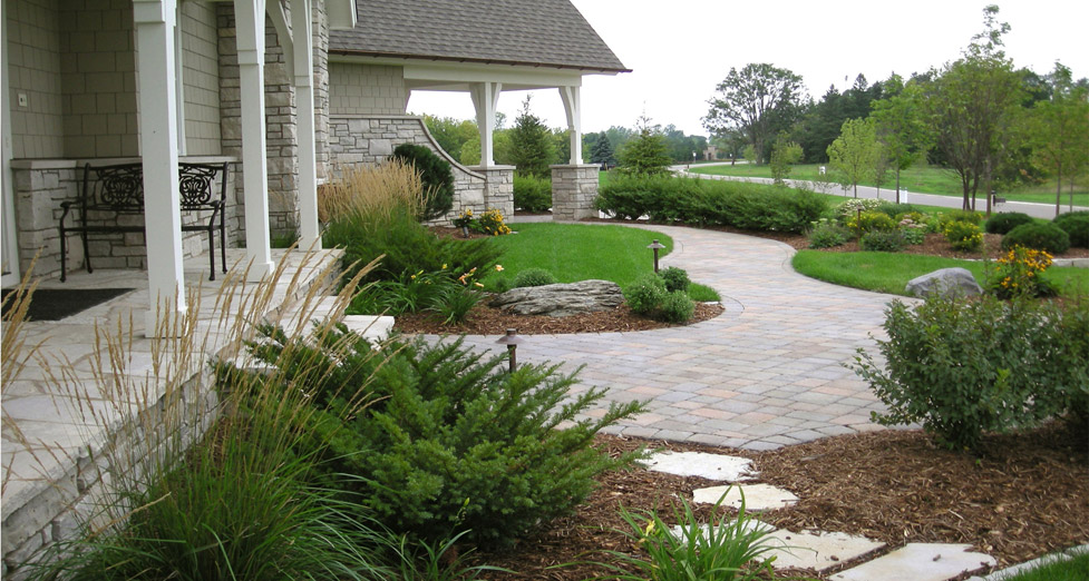 This Front Entry was Created Using a Mix of Pavers (Walkway), Limestone (Pathway), Boulder Outcroppings, and Plantings.