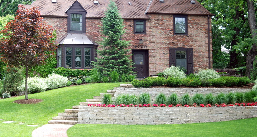 "This Front Entry Required ""Tiered Retaining"" Created with Limestone Walls/Steps, Paver Walkway, and Plantings."