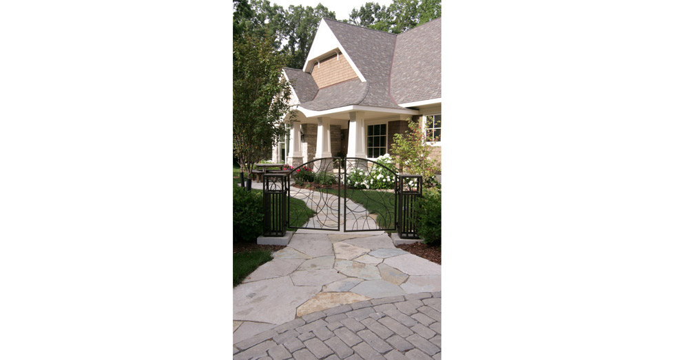 """Mix Media"" Front Entry with Irregular Limestone Walkway Leading off of the Paver Driveway thru the Custom Metal Gate Designed and Installed by Yarscapes, Inc.."