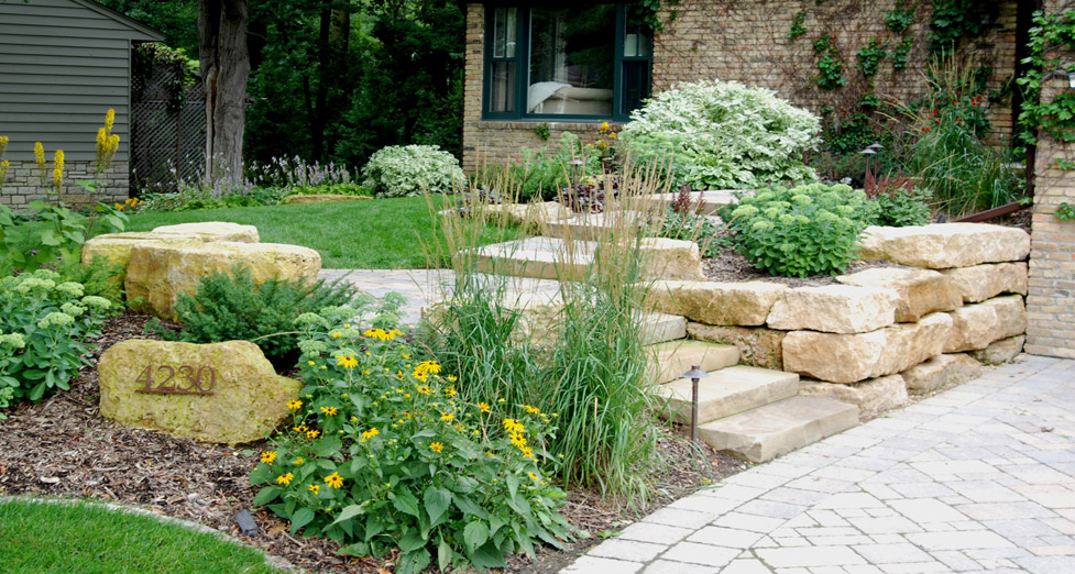 "For this ""Naturalistic"" Front Entry We Used Limestone Slabs for the Walls & Steps, Pavers for the Driveway, & Varied Plantings."