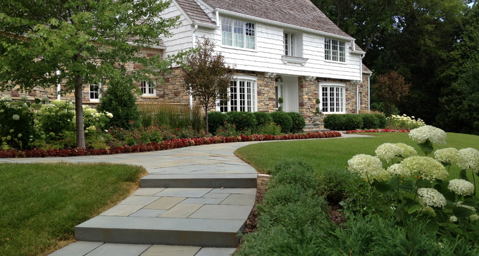 "This ""Newly Updated"" Home Required a ""Refreshed"" Front Entry; Achived by Installing a Bluestone Path & Varied Plants."