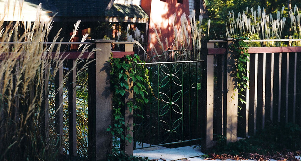 Antique Gate Attached to Wood Fencing.