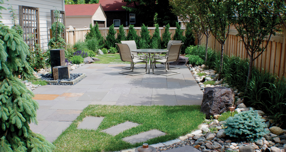 """Asian Inspired"" Space with Bluestone Patio/Accents, Waterfeature, & Plantings."