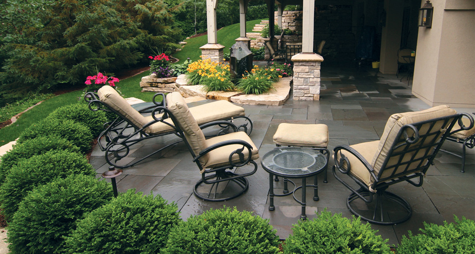 "This ""Intimate"" Backyard was Created Using a Bluestone Patio, Balsalt Water-Feature, Flagstone Bases, & Plantings."