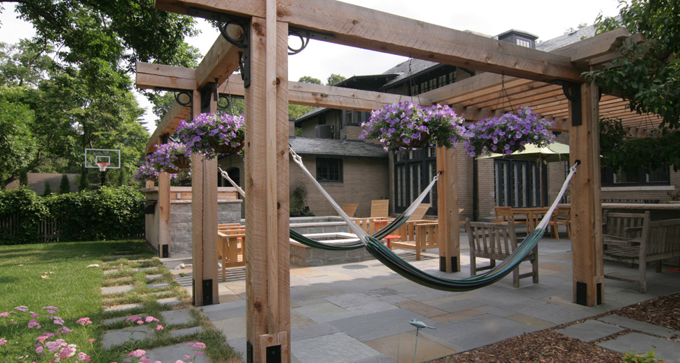 Custom Arbor System Built for Hammocks. Bluestone Patio with Custom Concrete Spa Behind.