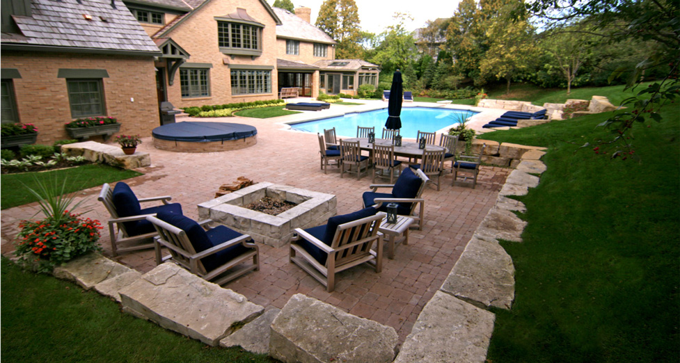 "Custom Concrete Pool/Spa, Paver Patio, & Limestone Walls/Firepit Give this Space ""Room to Move"" within."