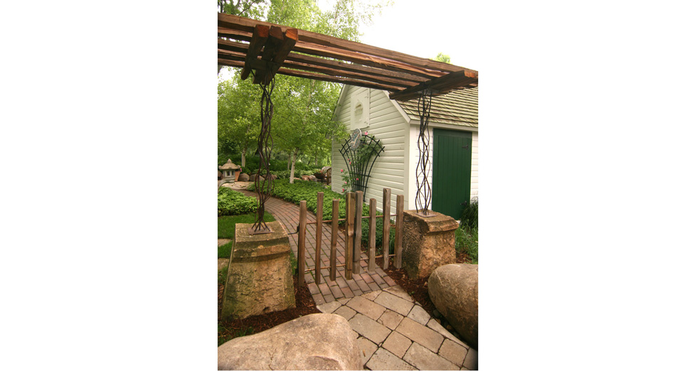 Custom Split Rail Gate and Pergola with Metal Accents and St.Paul Courthouse Stone Bases.
