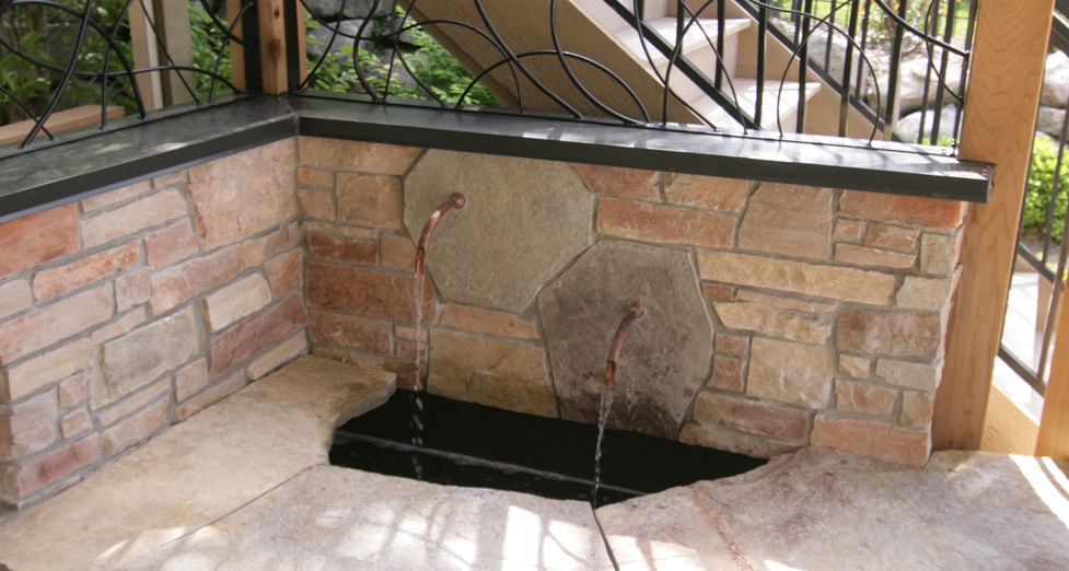 "Custom ""Built-In"" Water feature with Metal Accents Behind, Copper Piping in a Mortared Limestone Wall."