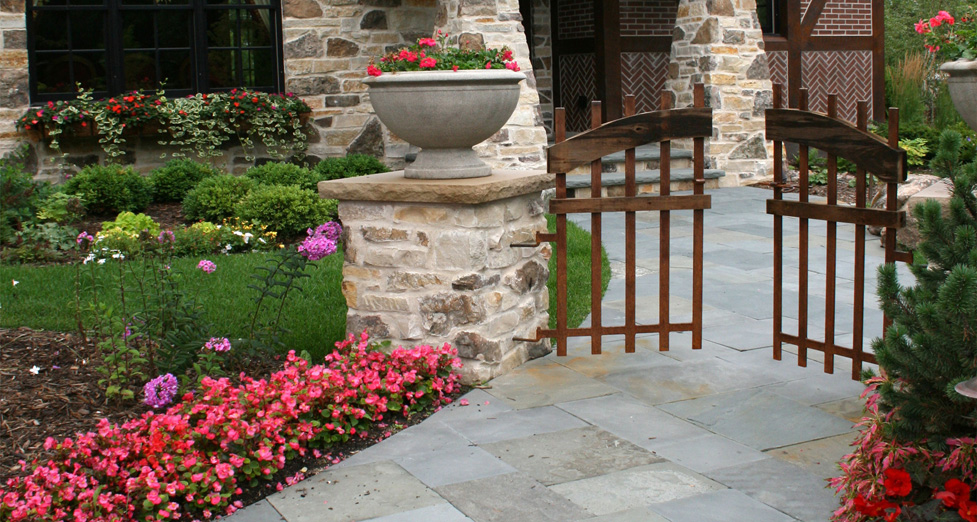 Custom Wood Gate on Stone Columns Over Bluestone Walkway.