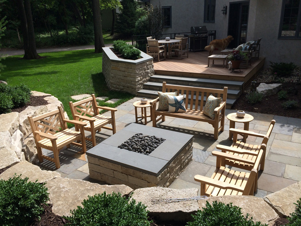 Entertaining Area with New Wood Deck, Raised Limestone Planter and Walls, Bluestone Patio and Stone Gas Fire Pit.