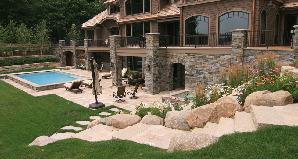 "New ""Tear Down-Rebuilt"" Home on Lake Minnetonka with Raised Concrete Pool and Spa with Travertine Patio. Limestone Staircase with Boulder and Limestone Retaining Walls."