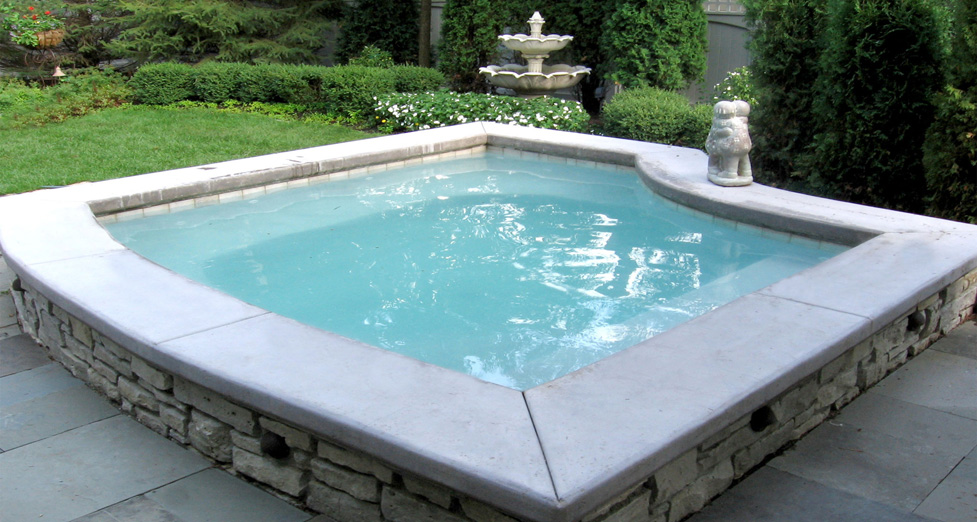 "This Client Wanted a ""Spa/Dipping"" Pool. We Built it Slightly Larger than Your Average Spa, with a Mortared Limestone Exterior."