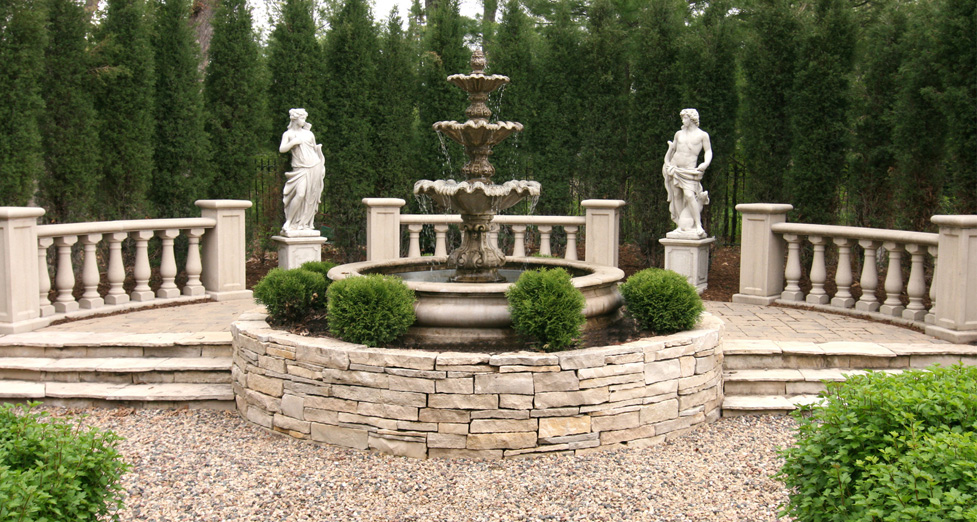 Stone 3-Tier Fountain with a Limestone Dry-Laid Wall Surrounding.