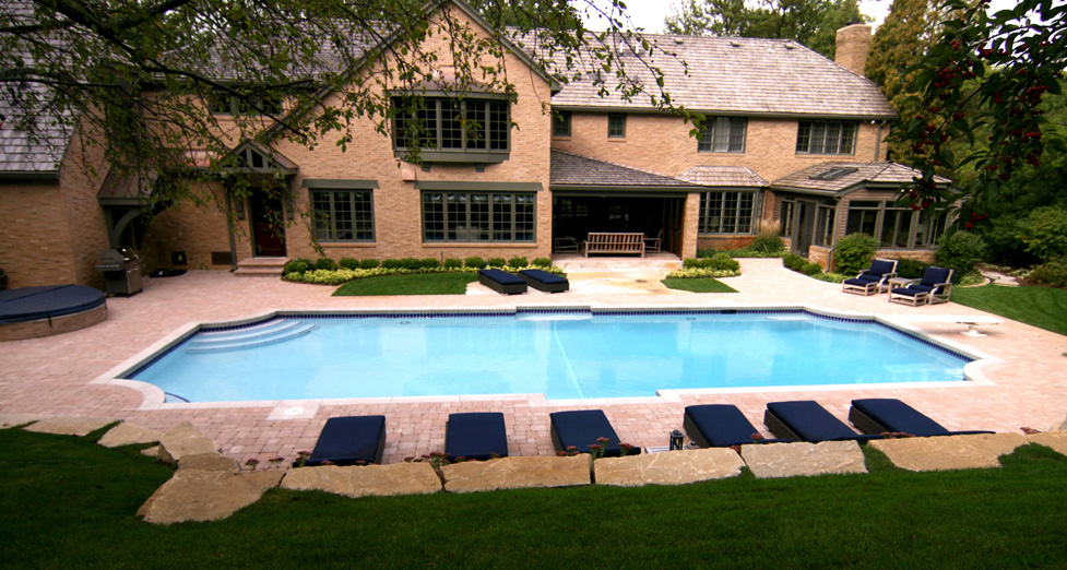 "A ""View from the Top"" of this ""Stylized"" Custom Concrete Pool, Limestone Walls, & Paver Patio."