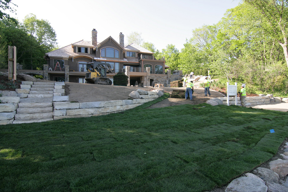 View From the Lake of Crew Installing Sod
