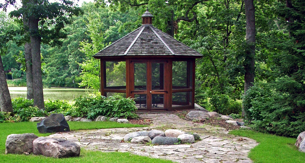 Wood Gazebo with Boulder Fire-Ring Fire Pit and Boulders for Seating.