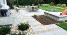 Bluestone Patio with Irregular Patterns and Limestone Seating Walls