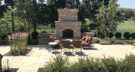 Country Entertaining with Mortared Fireplace an Travertine Patio and Plantings