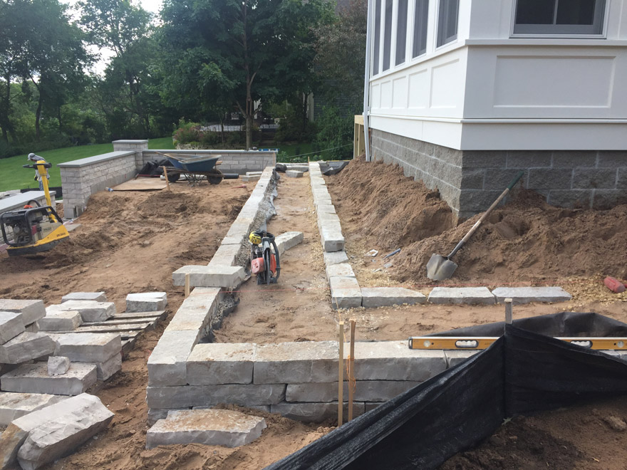 Limestone Retaining Walls with Multi-Level Plantings