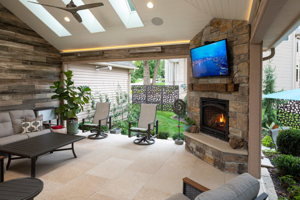 Stone Fireplace and OUTDECO Screens on Screen Porch Addition in Eden Prairie