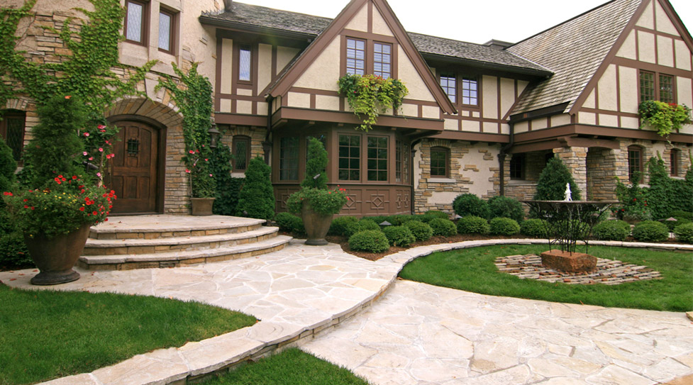 "We Created this ""Chateau"" Style Entry Way Using Irregular Flagstone, Plantings, and Custom Metal Water Feature."
