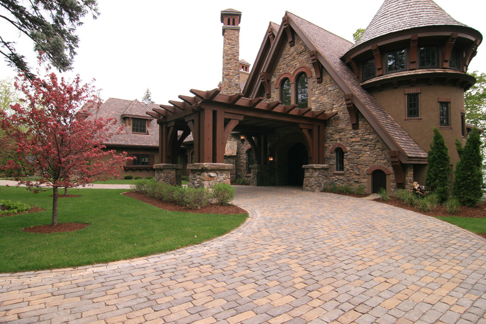 "This ""Drive Thru"" Front Entry was Created Using Tumbled Pavers and Plantings to Accent the Architecture of the Home"