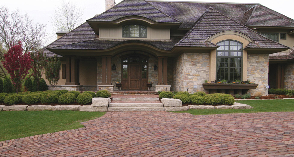 "This New Construction Home Required an ""Aged"" Feel, So We Used Oldworld Pavers, Limestone Slab for Steps/Wall, Plantings."