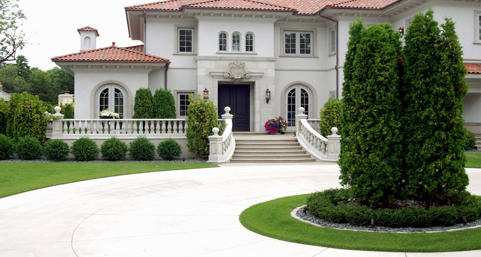 "This ""Spanish Style"" Home Required a ""Manicured Look"", Achieved by Using Shaped Plant Material and a Concrete Driveway."