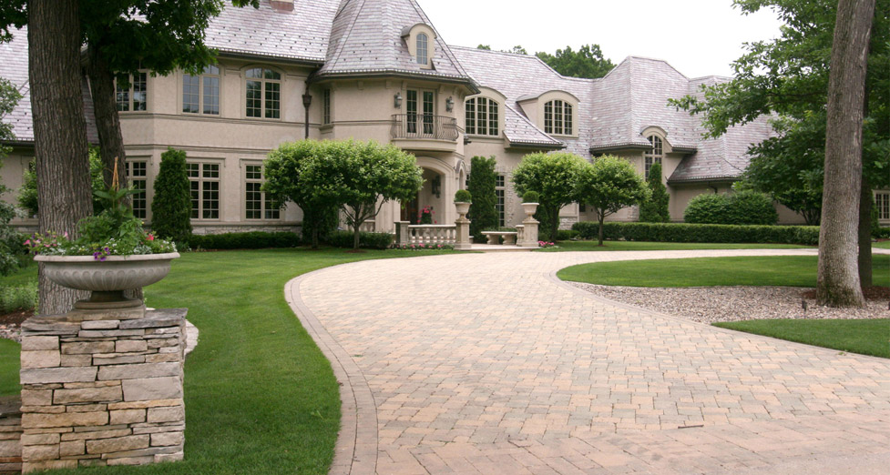 "This ""U' Shaped Driveway was Created Using Pavers with a Dry-Stacked Limestone Pillar at the Entrance."
