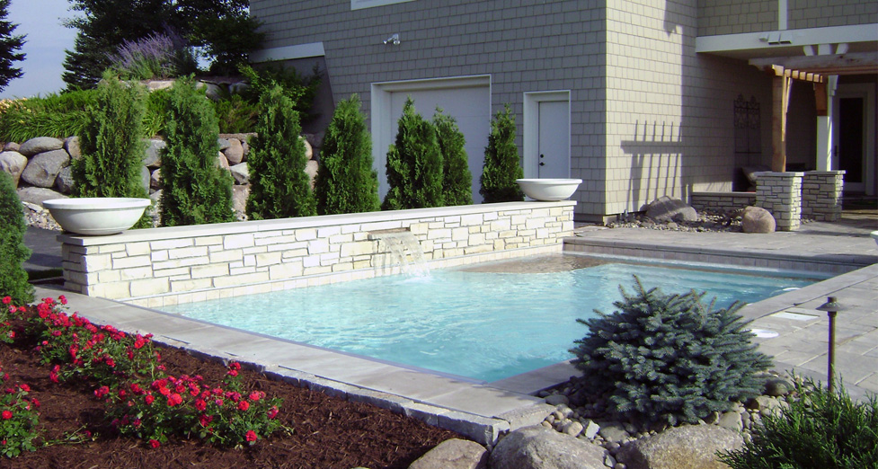 "This Beautiful Custom Pool with Water Feature & Raise Stone Wall was Created as an ""After-thought"" to the Initial Landscaping."