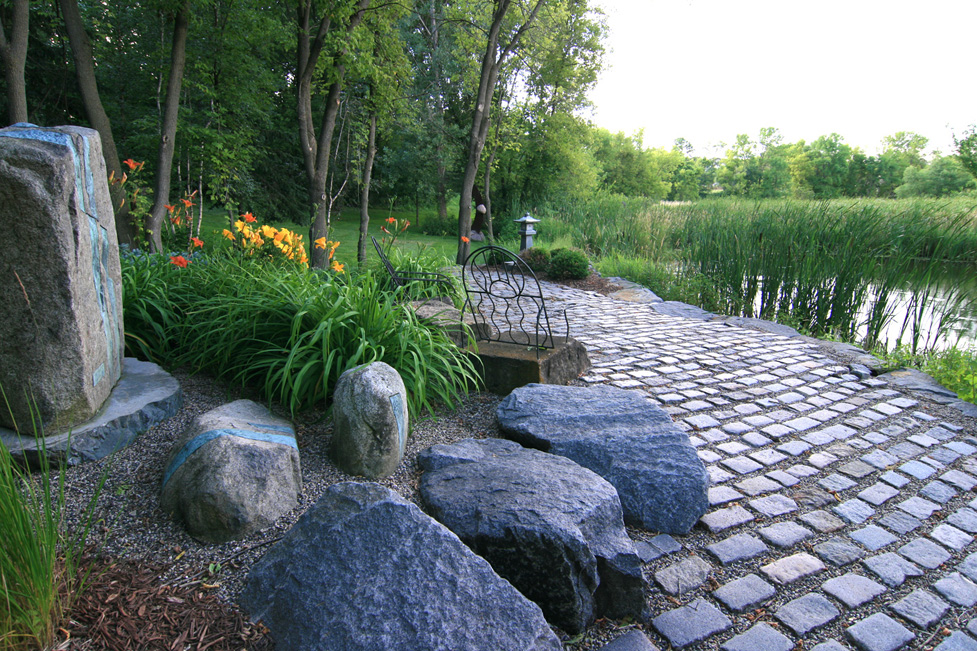 A Cobblestone Paver Patio Overlooking Natural Wetlands