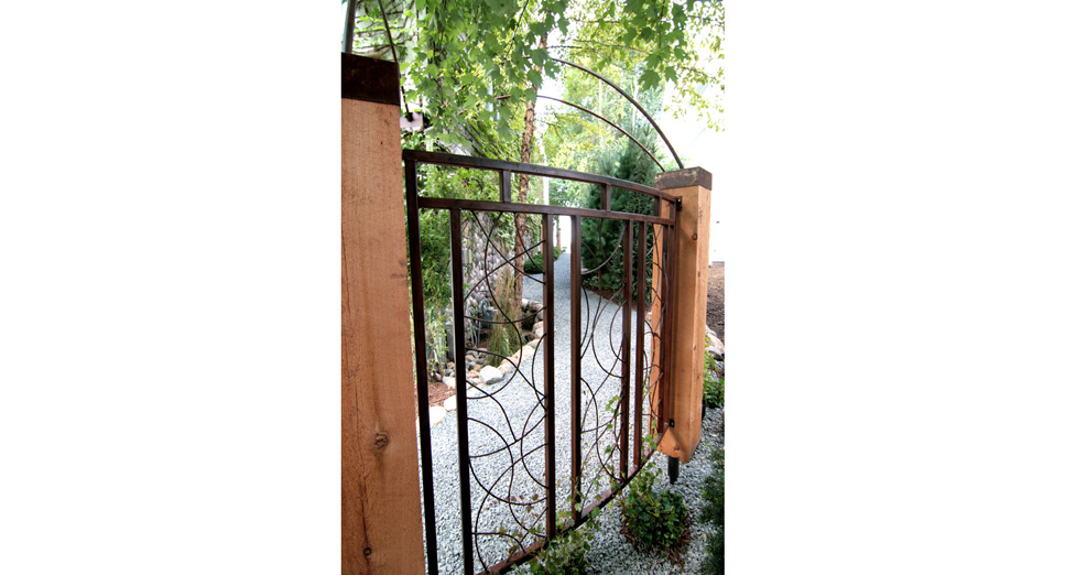 Custom Metal Fence Sections Attached to Wood Post with Metal Matching Tops