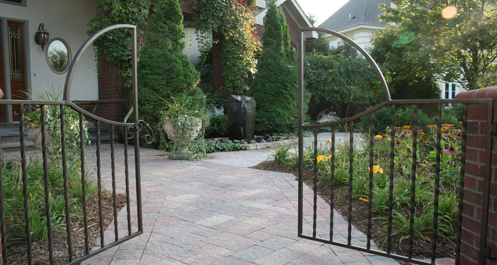 Custom Metal Gate Attached to Brick Mortared Columns.