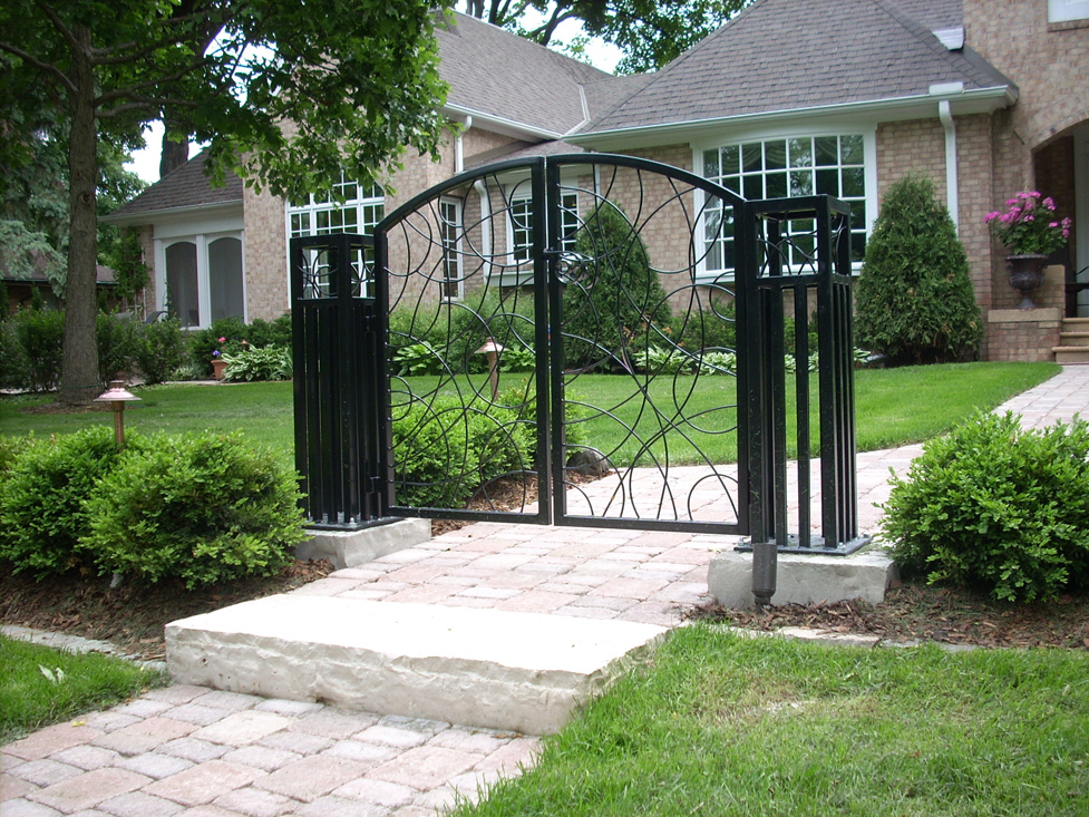 Custom Metal Gate Attached to Limestone
