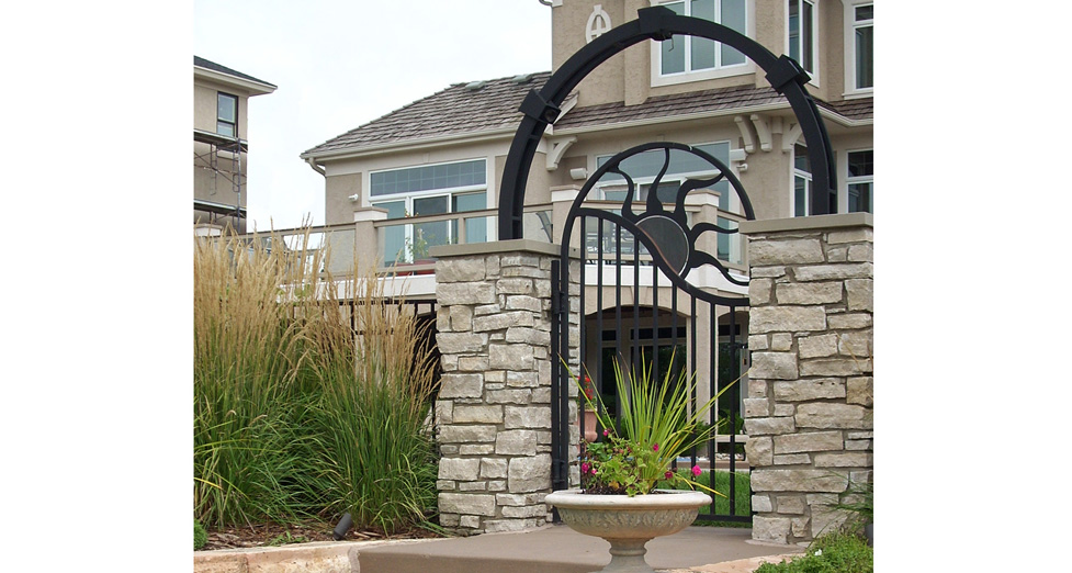 Custom Metal Gate with Mortared Limestone Columns.
