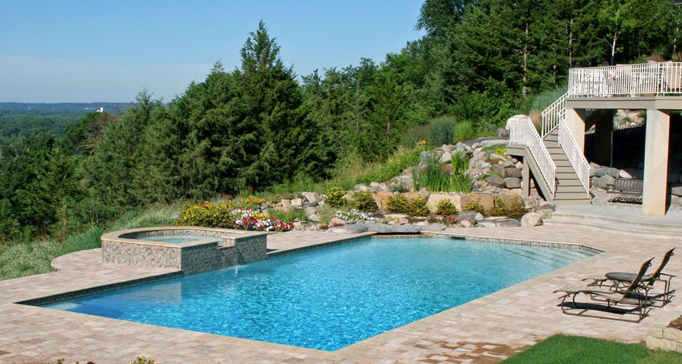 This Custom Pool and Spa was Enhanced by Adding a Natural Water Fall & Paver Pool Deck.