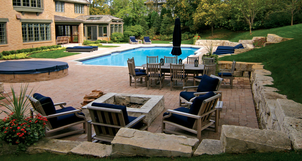 "This ""Custom Remodeled Backyard"" was Compete with a Custom Pool/Spa, Fire Pit, Limestone Walls, Paver Terrace, & Plantings."