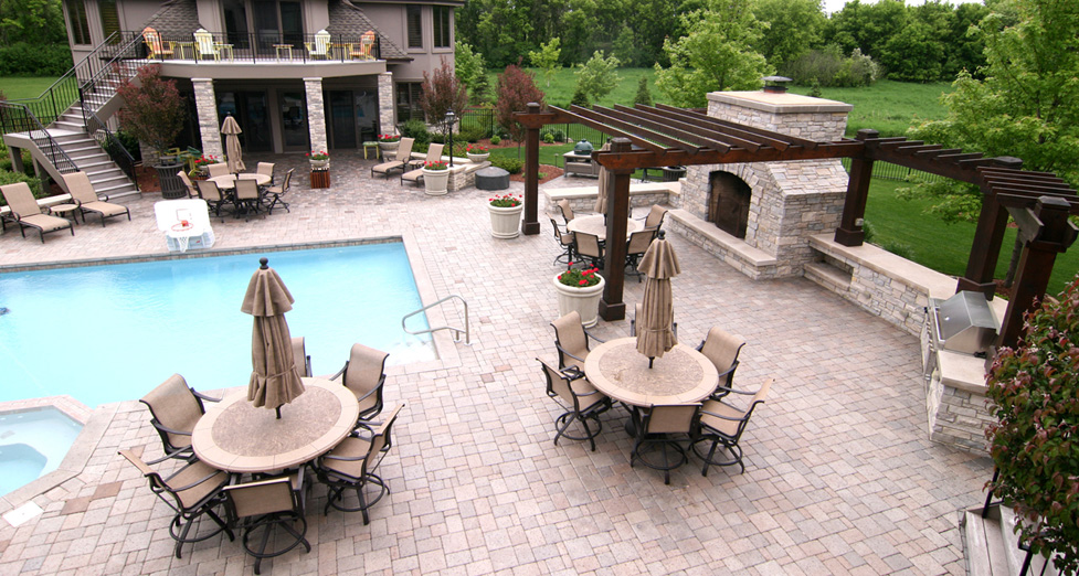 "A ""Dream"" Entertaining Area with Custom Concrete Pool and Spa, Outdoor Kitchen, and Fireplace."