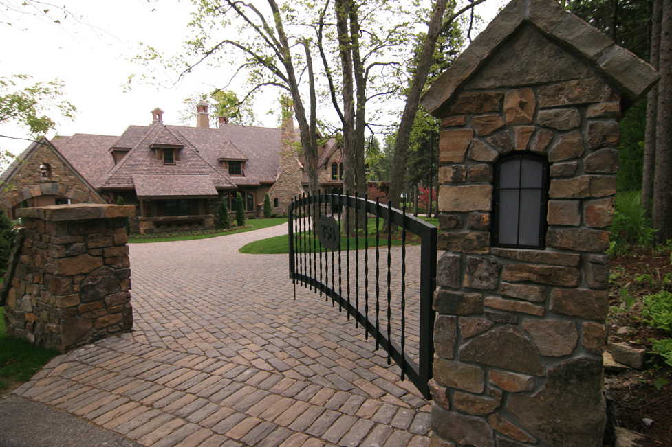 Welcome to this Front Entry Complete with Custom Metal Gate and Mortared Stone Pillars.