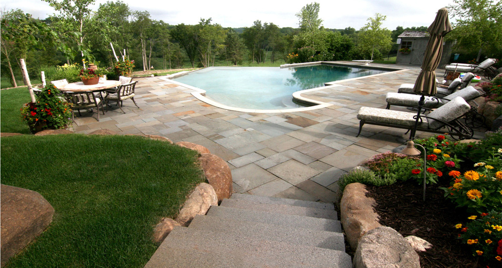 "Granite Steps & Bluestone Patio Adorn this ""Expansive"" Pool; Which Feels Like You Could Swim Right into the Forest."