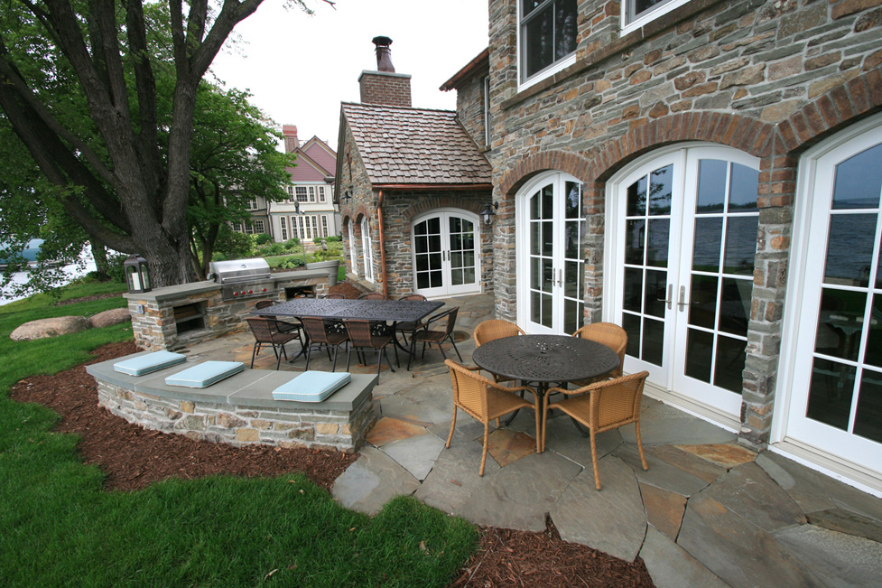 Irish Cottage on Lake Minnetonka with a Custom Outdoor Kitchen, Seating Wall, and Flagstone Patio.