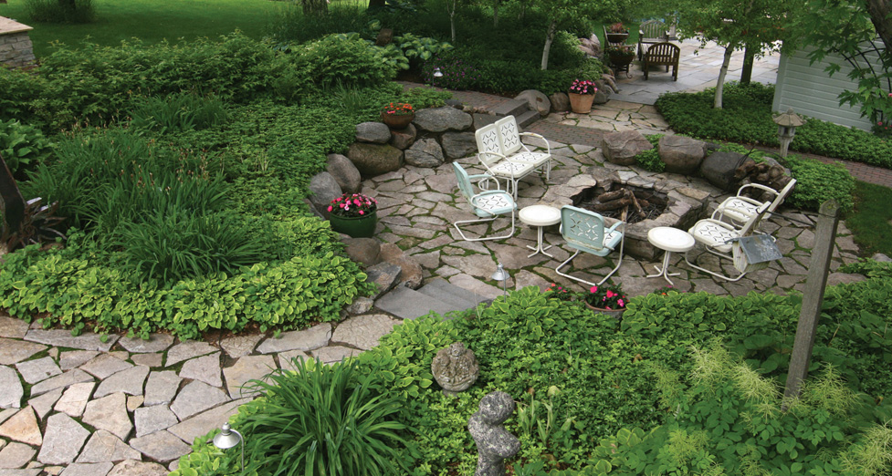 "Irregular Limestone Patio, Boulder Retaining Walls and a Limestone Fire Pit Create this ""Rustic & Casual"" Atmosphere."