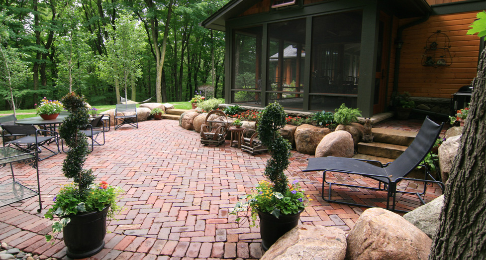 """Northern MN Feeling"" Home with Old World Pavers, Boulder Retaining, & Natural Plantings."