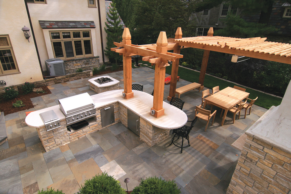"""Outdoor Entertaining"" with Custom Kitchen, Wood Pergola with Heater, Gas Fire Pit and Pizza Oven."