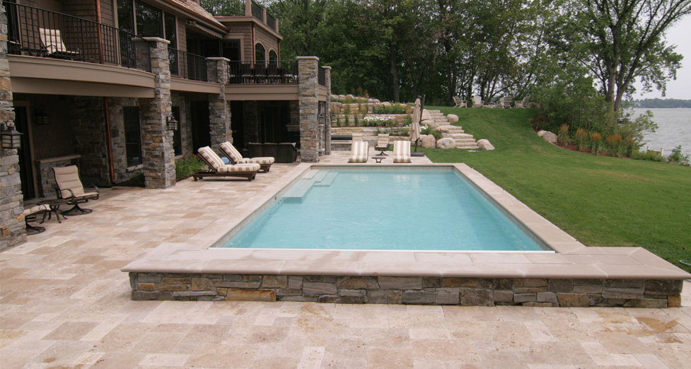 Raised Concrete Swimming Pool with Limestone Detail