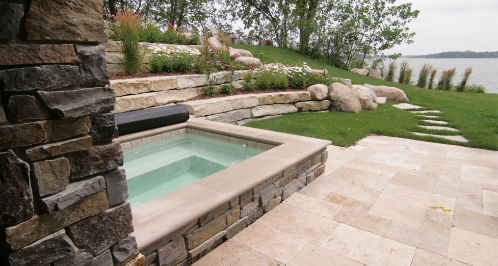 Raised Custom Concrete Spa with Limestone Detail