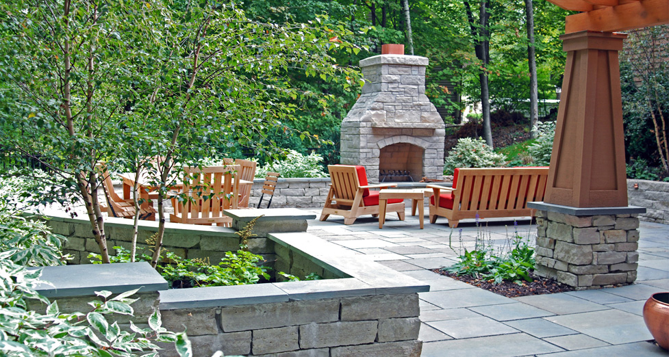 "This ""Raised Terrace"" was Completely Redone with a Stone Fireplace, Bluestone Patio, & Flagstone Walls Topped with Granite."